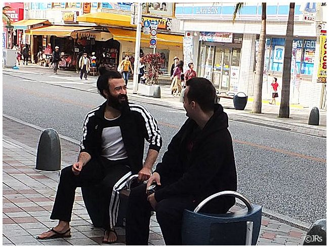 Two friends talking on the main drag in Naha.