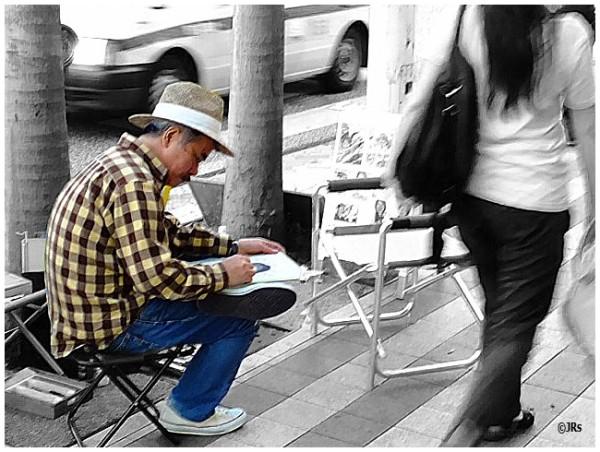Street artist hoping for a customer:)