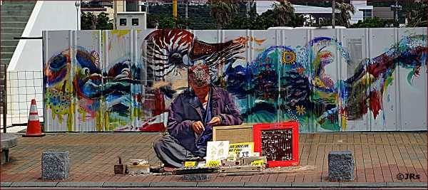 Selling his art on the street.