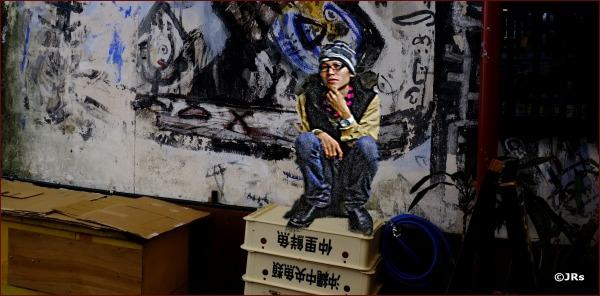 Boy on a wall.