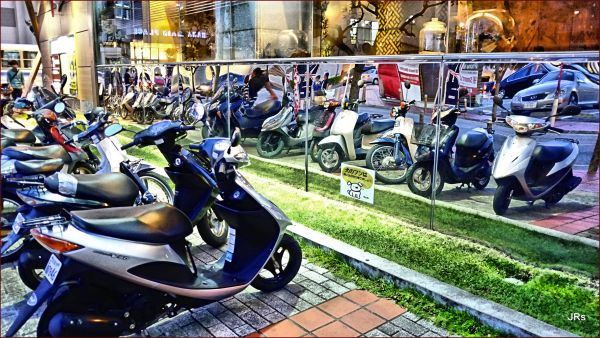 Relections of scooters.