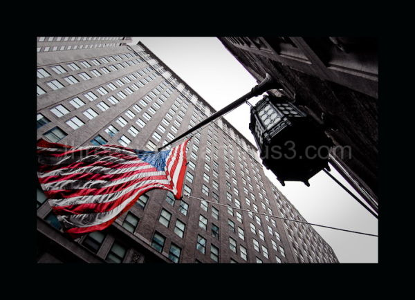 American Flag and Lamp on Wall Street