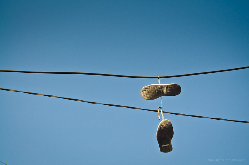 Shoes on powerlines.