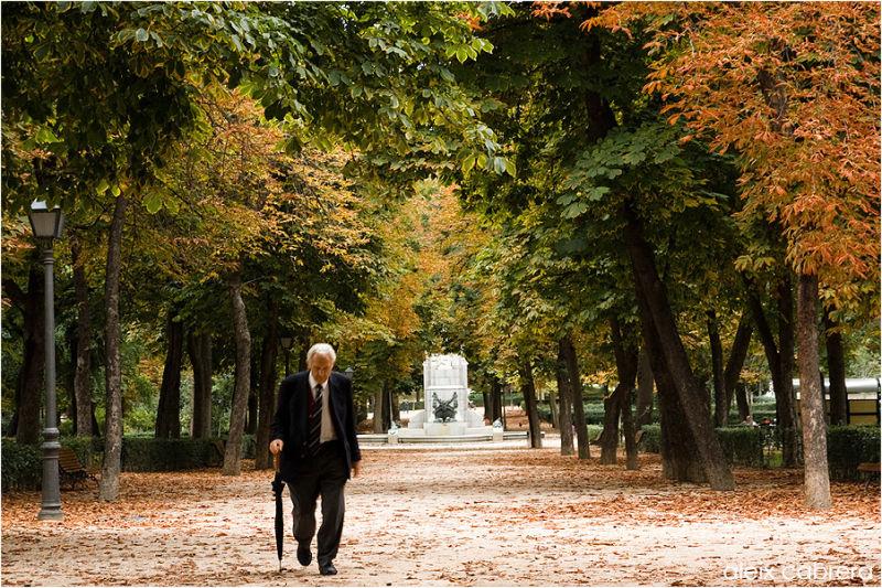 An old man crossing Retiro Park in Madrid
