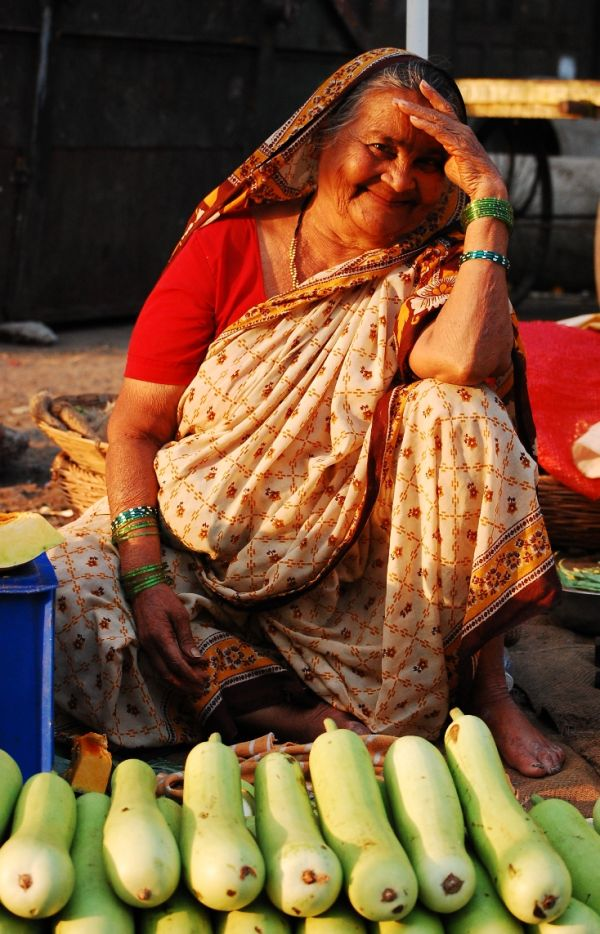 Smiling Old Woman Vegetable Seller
