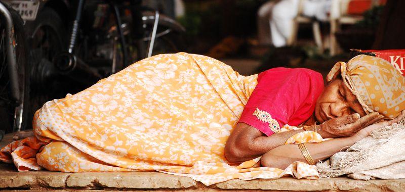 woman sleeping peacefully on street