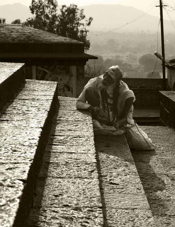 Sadhu sitting on the steps of Jejuri Temple