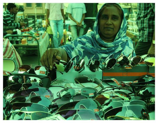 Woman selling sun-glasses