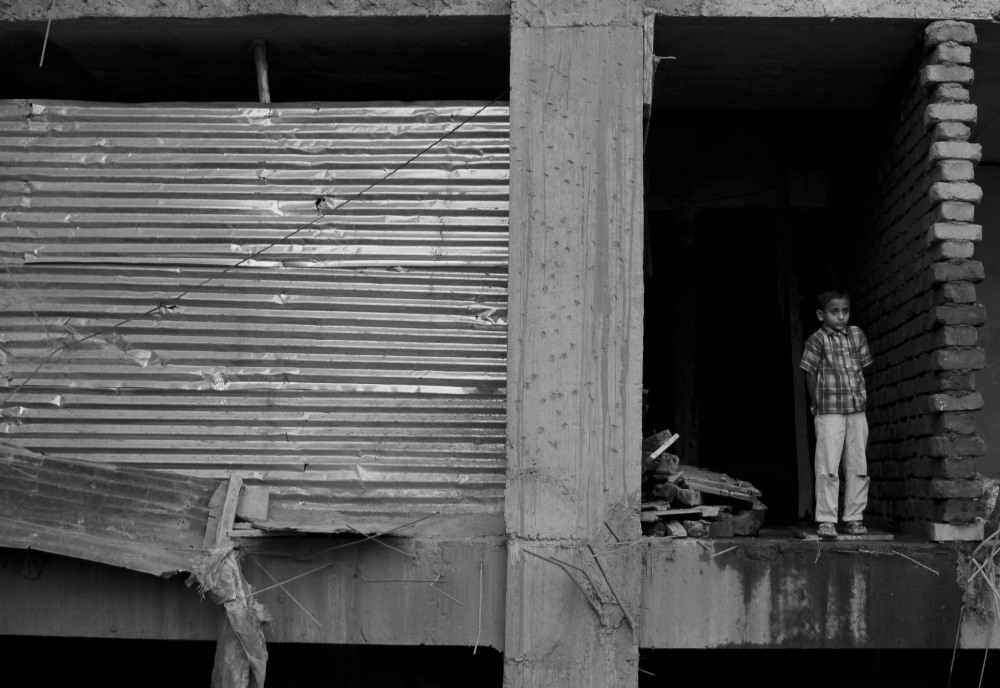 Boy standing at a construction site in Kasbapeth