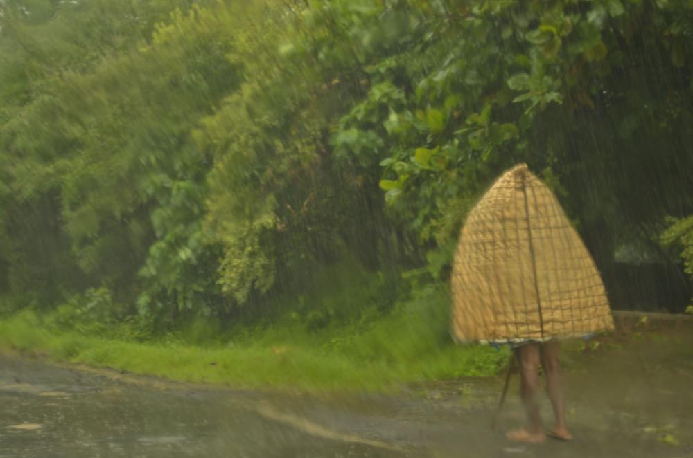 Old man walking in rain