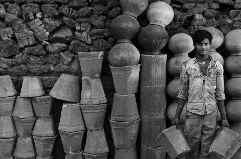 Boy carrying pots at Kumbharwada