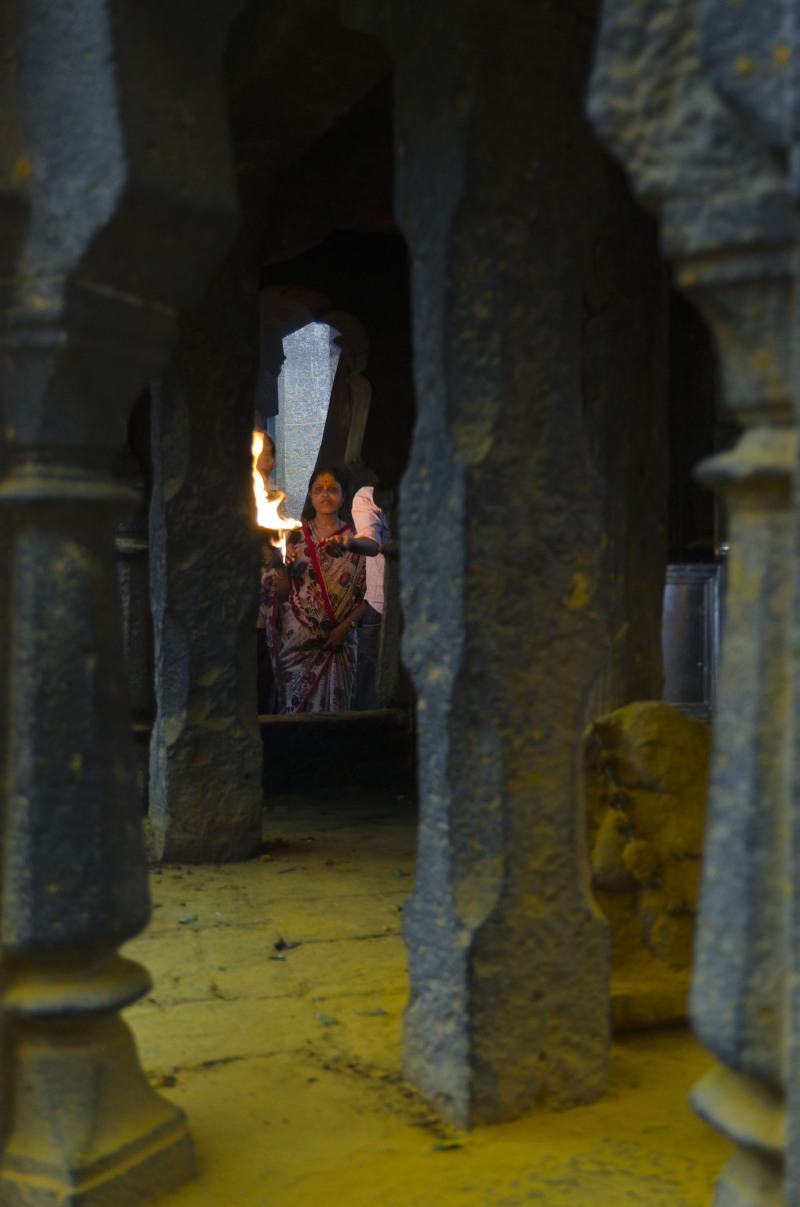 Lady praying at the Jejuri temple