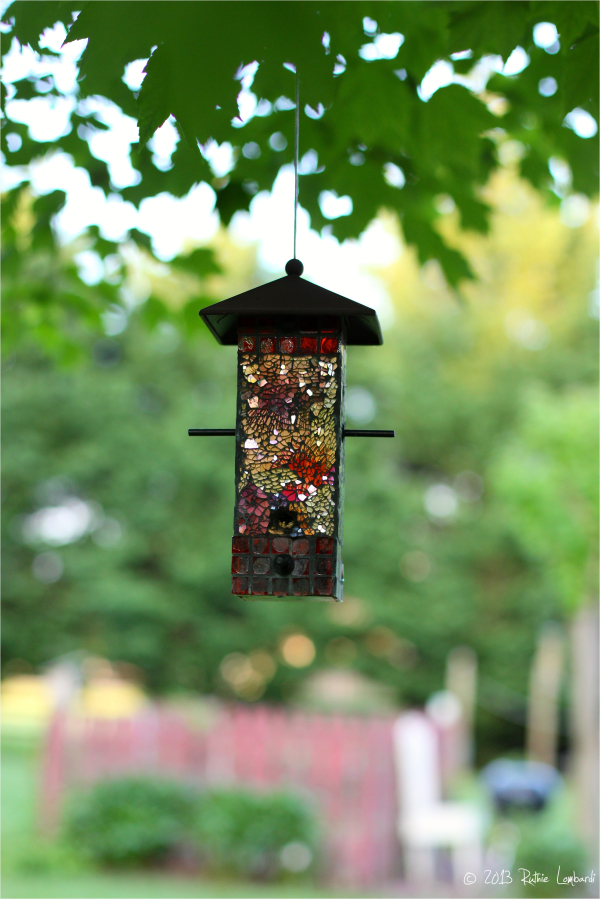 jeweled birdhouse in the backyard