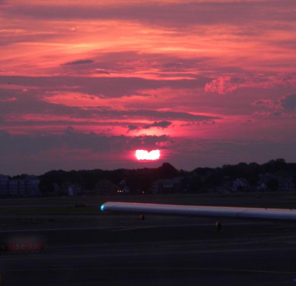 sun rising over the Boston airport