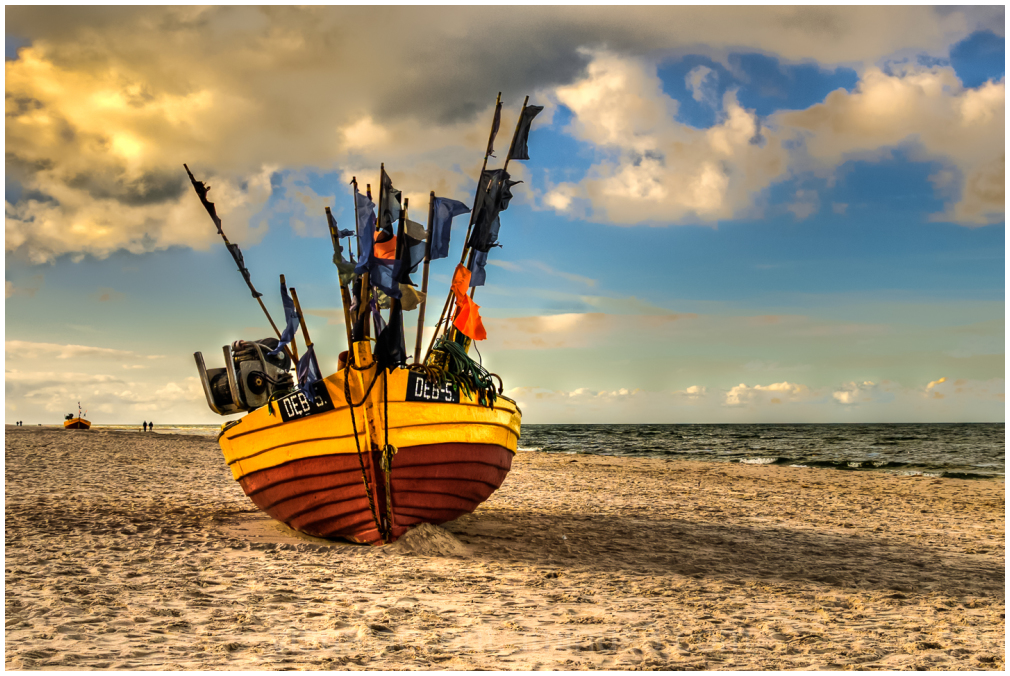 Fishing boat on the beach of Baltic sea.