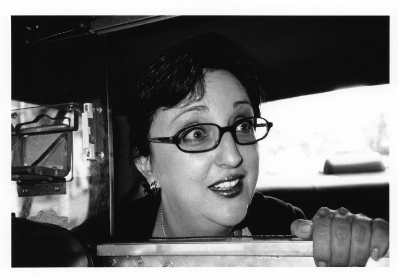 surprised woman in taxi