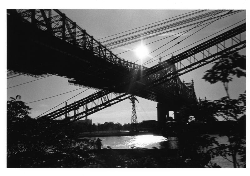 crossing of bridge and construction with sun light
