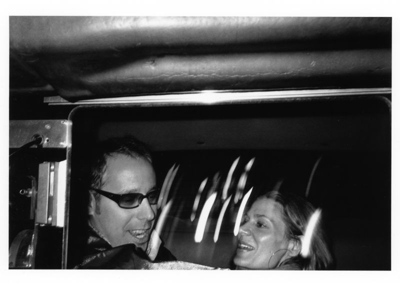 couple in a back seat taxi night