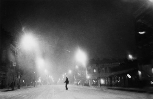 pedestrian in night blizzard