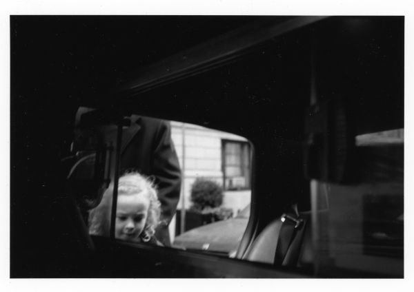 little girl getting in a taxi