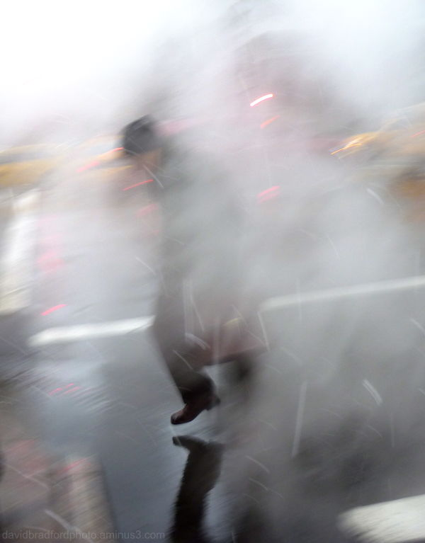 man in trench coat running in fog