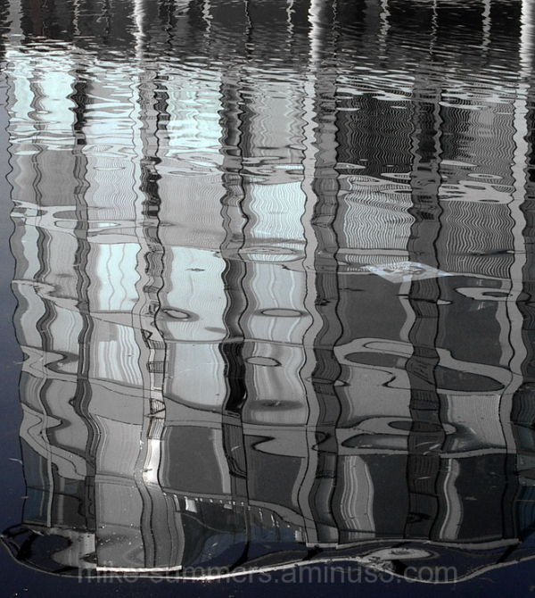 Modern building reflected in water