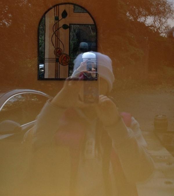 Self portrait in the window at Andrea's b&b