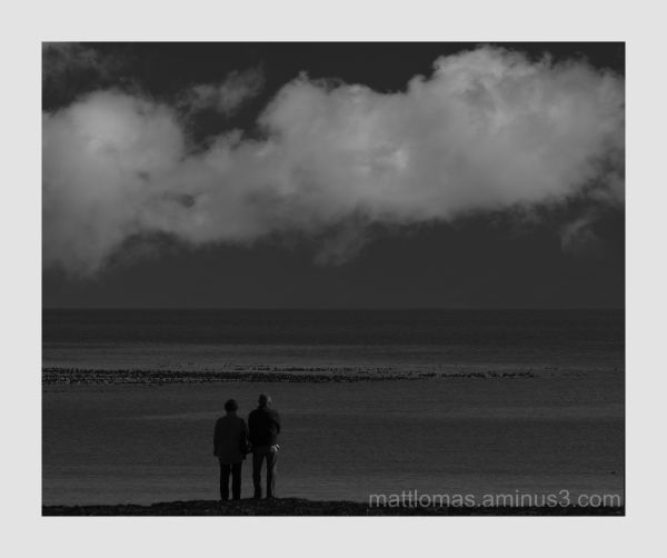 Couple watching the world go by In Robin Hoods Bay