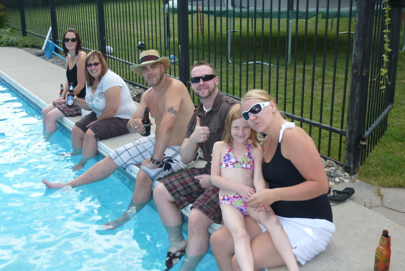 My family sitting around the pool