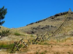 A really cool steep crooked climbing jack fence.
