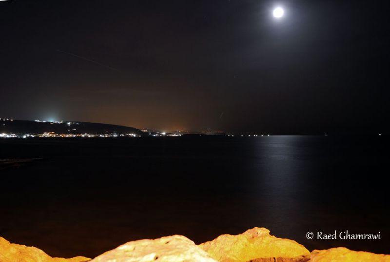 Sea, Moon and Rocks at night