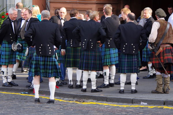 men in kilts outside the caledonian hotel