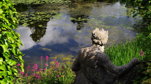 statue watching the water in a pond, powerscourt