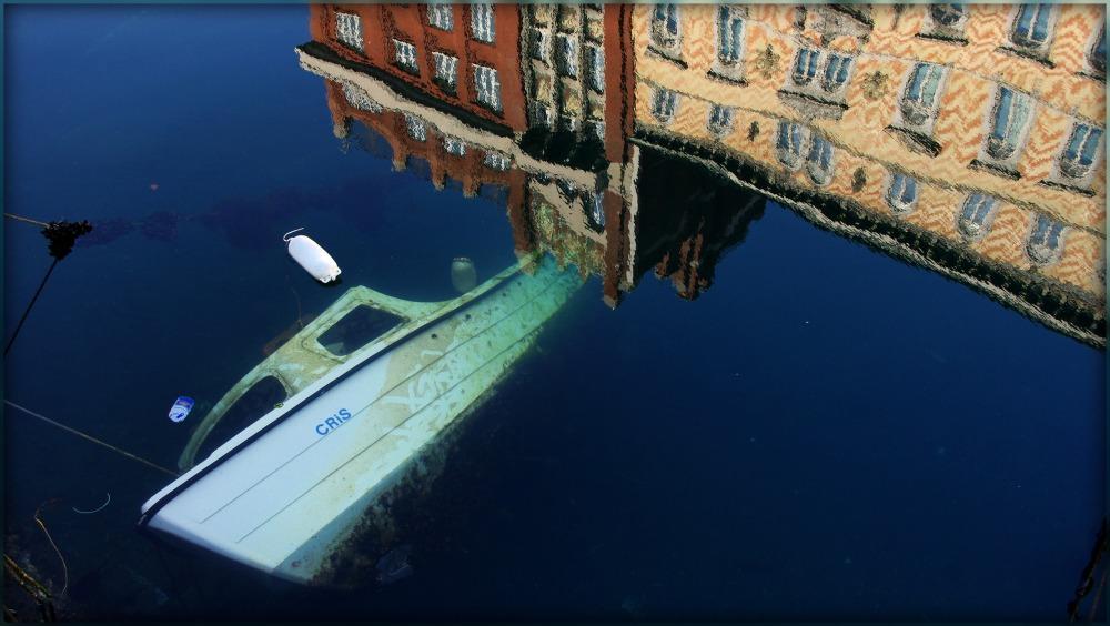trieste, sunken boat in canal grande