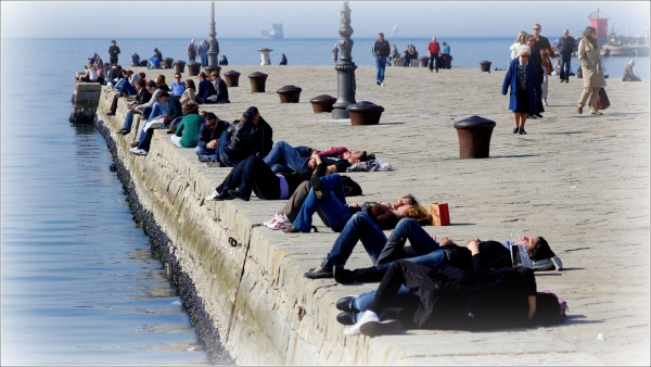 trieste, people lying in the sun on the pier