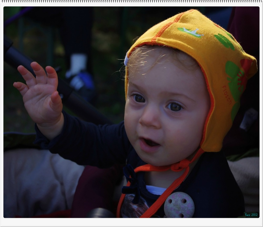 emilia, one year old, waving
