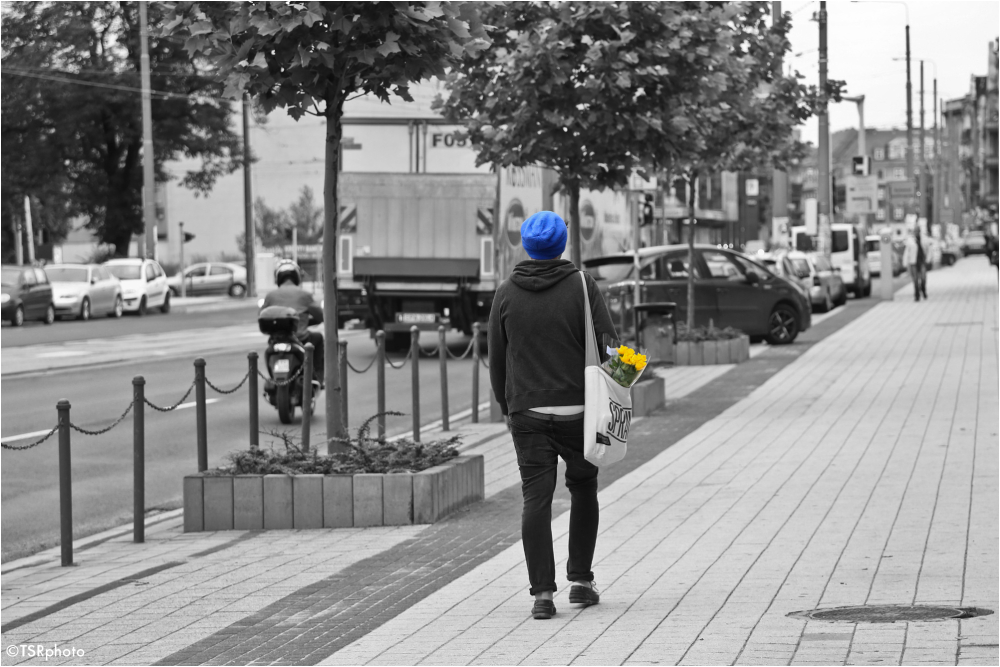 Man with the yellow flowers and blue cap.