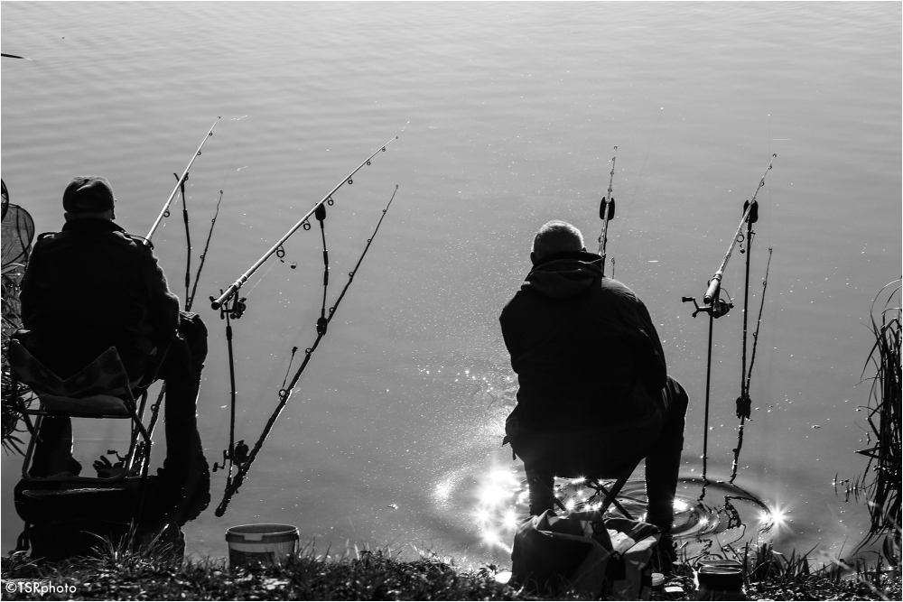 Two people, four fishing rod, no fishes.:-)