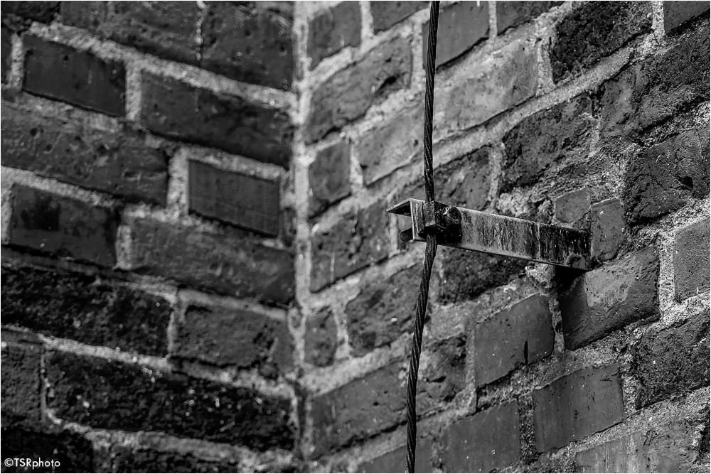 wall brick detail lightning conductor