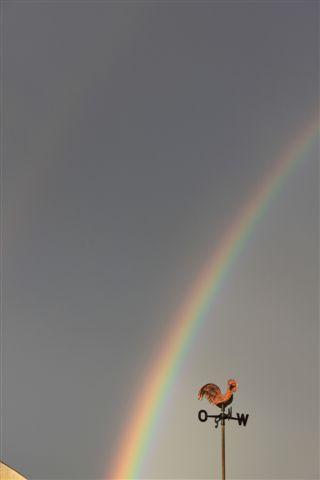 Lucht regenboog windhaan.