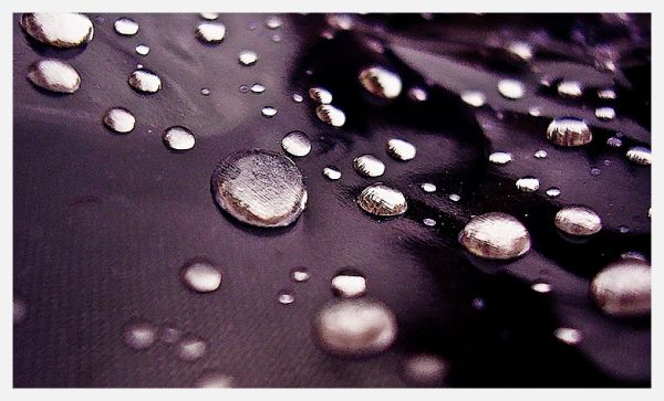 Drops on the hood of a baby chair waterproof