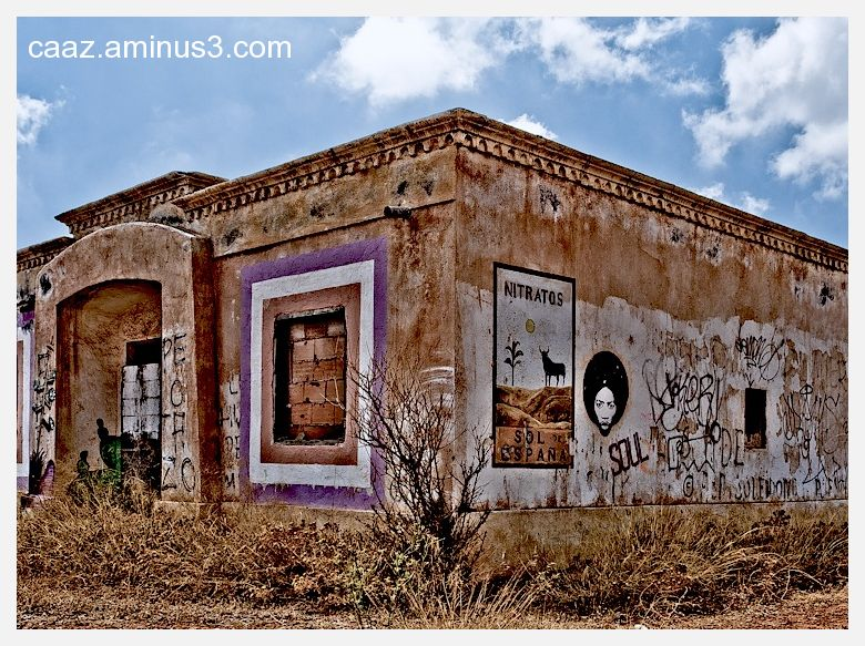 Abandoned building with an old ad and graffitis
