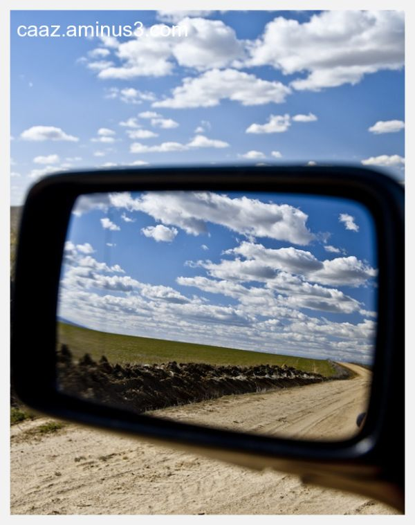 Reflexion of a landscape on the driving mirror