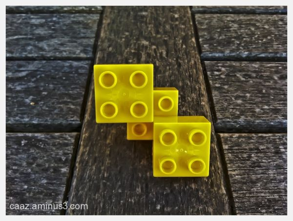 playing with Lego items on a wood table