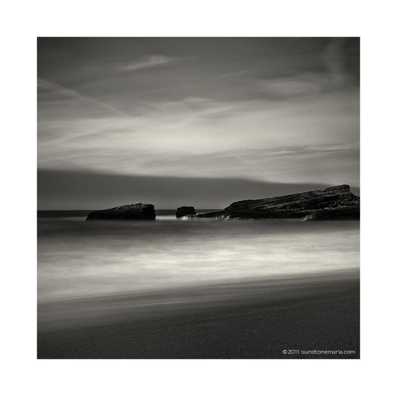 { sand, rocks, sky }