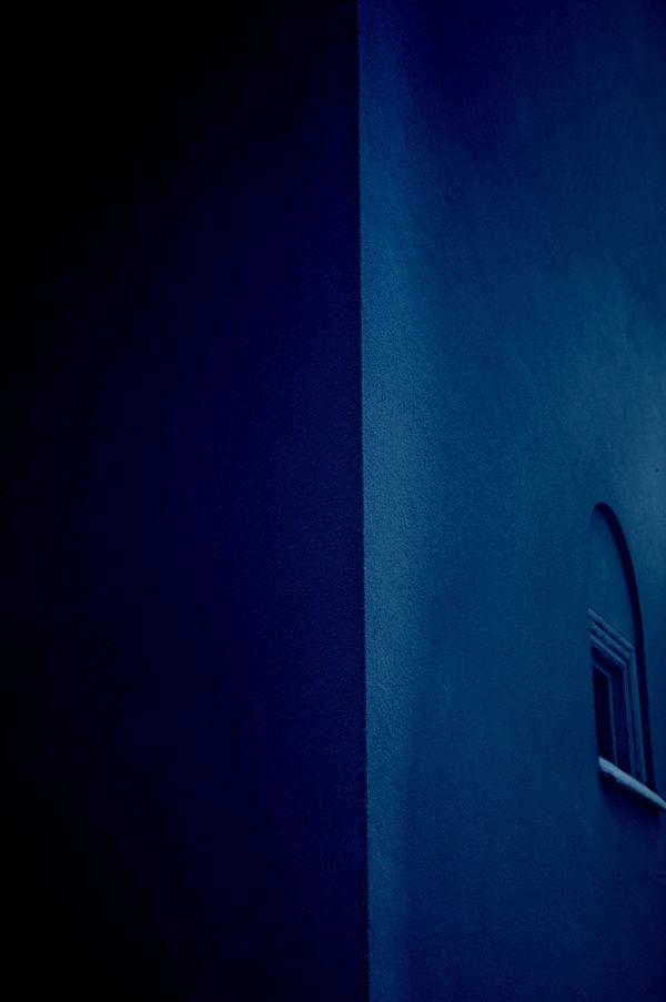 A strangely serene blue building facade.