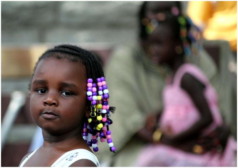 little girl with beaded hair