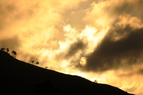 Sun burning clouds away