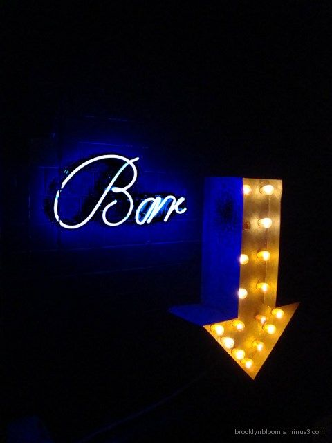 neon bar sign in east village nyc