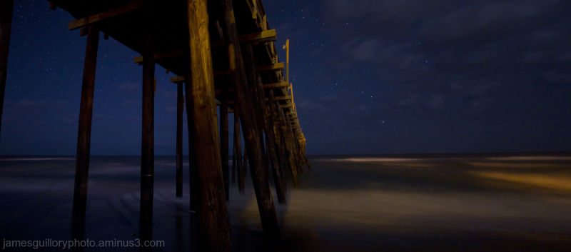 rodanthe pier under a night sky at the outer banks